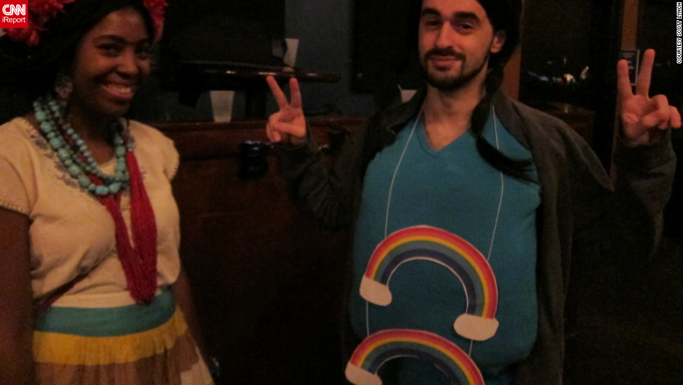 "The man on the right is sporting the Double Rainbow meme at the <a href=""http://ireport.cnn.com/docs/DOC-864935"">HallowMEME</a> costume party.  The <a href=""http://knowyourmeme.com/memes/double-rainbow"" target=""_blank"">Double Rainbow</a> became an Internet sensation after the video ""Yosemitebear Mountain Giant Double Rainbow 1-8-10"" went viral online."