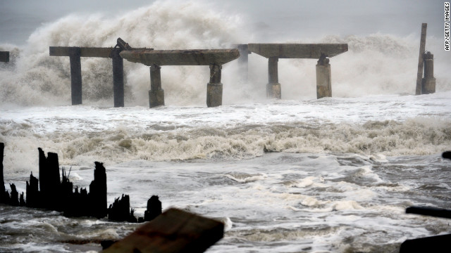 Waves crash against a previously damaged pier in Atlantic City, New Jersey, as Hurricane Sandy approaches landfall on Monday, October 29.