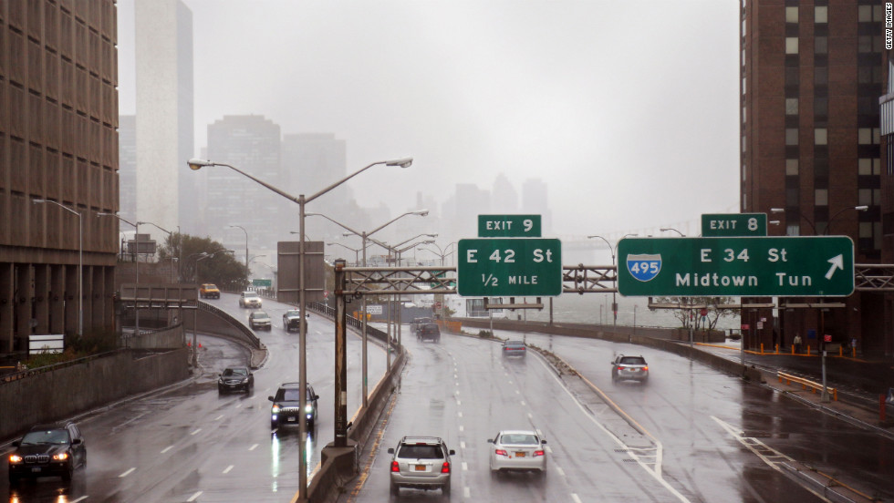 Motorists drive on FDR Drive along the banks of the East River in Manhattan on Monday before Hurricane Sandy makes landfall.