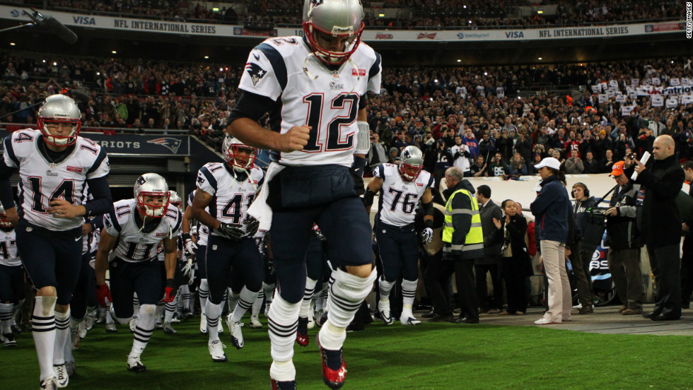 Tom Brady leads the New England Patriots onto the field for the match against the St. Louis Rams.
