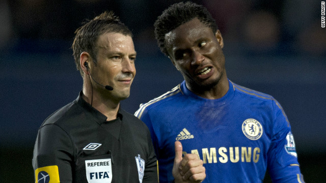 Chelsea's midfielder John Obi Mikel talks with referee Mark Clattenburg during the Premier League clash with Manchester United