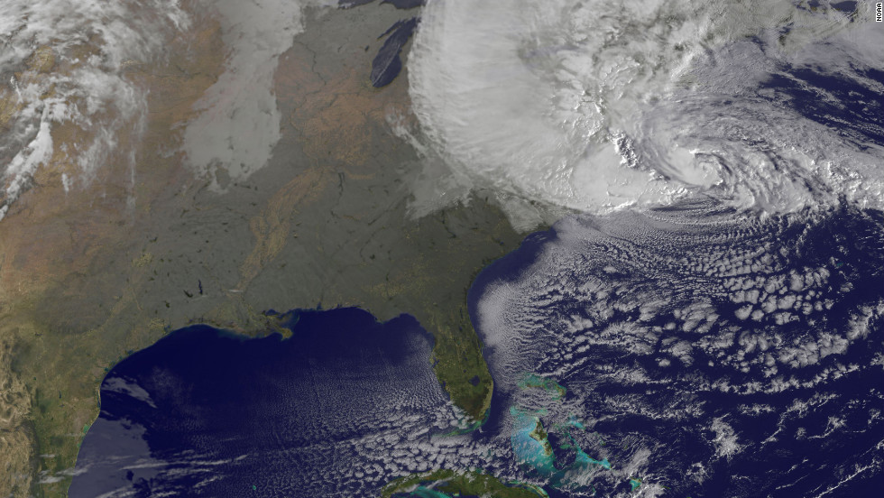 "A satellite image shows Hurricane Sandy at 8:25 a.m. ET Monday. Forecasters warned that Sandy was likely to collide with a cold front and spawn a ""superstorm"" that could generate flash floods, snowstorms and massive power outages."