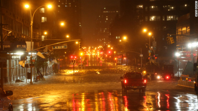 NEW YORK, NY - OCTOBER 29:  A view of the corner of 34th Street and 1st Street in Manhattan during rains from Hurricane Sandy on October 29, 2012 in New York City.  Hurricane Sandy, which threatens 50 million people in the eastern third of the U.S., is expected to bring days of rain, high winds and possibly heavy snow. New York Governor Andrew Cuomo announced the closure of all New York City will bus, subway and commuter rail service as of Sunday evening. (Photo by Michael Heiman/Getty Images)