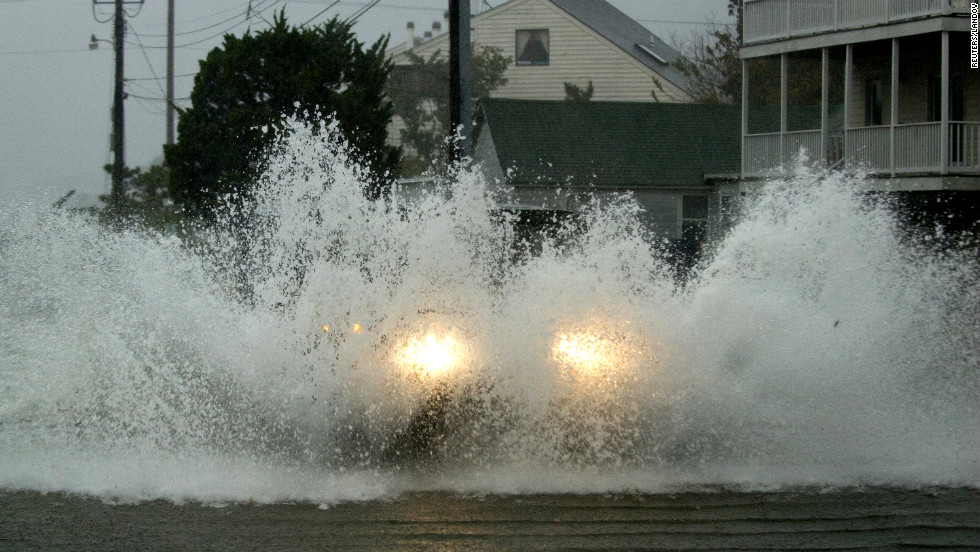 An emergency vehicle plows through floodwaters on Monday in Dewey Beach, Delaware.