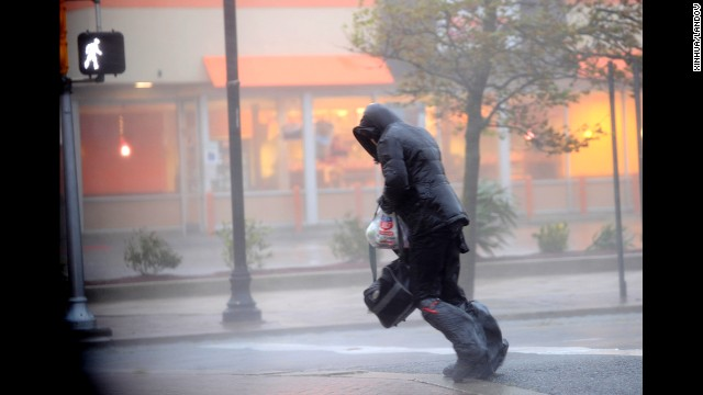 Image #: 19925547    (121029) -- ATLANTIC CITY, Oct. 29, 2012 (Xinhua) -- A person tries to cross the street in Atlantic City, New Jersey, the United States, Oct. 29, 2012. Hurricane Sandy is on Monday churning its way towards the U.S. East Coast, poised to make landfall near Atlantic City on Jersey Shore in the evening. The city itself is like a ghost town, with casinos shuttered, tourists fled and many parts of the town inundated in knee-high water.    (Xinhua/Zhang Jun)       XINHUA /LANDOV