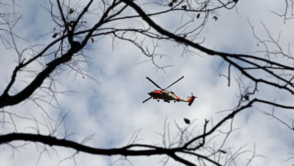 A U.S. Coast Guard helicopter flies over Central Park in New York City.