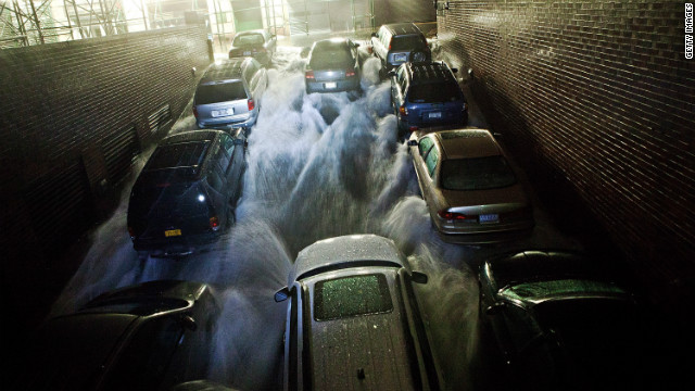 NEW YORK, NY - OCTOBER 29: Rising water, caused by Hurricane Sandy, rushes into a subterranian parking garage on October 29, 2012, in the Financial District of New York, United States. Hurricane Sandy, which threatens 50 million people in the eastern third of the U.S., is expected to bring days of rain, high winds and possibly heavy snow. New York Governor Andrew Cuomo announced the closure of all New York City will bus, subway and commuter rail service as of Sunday evening (Photo by Andrew Burton/Getty Images)