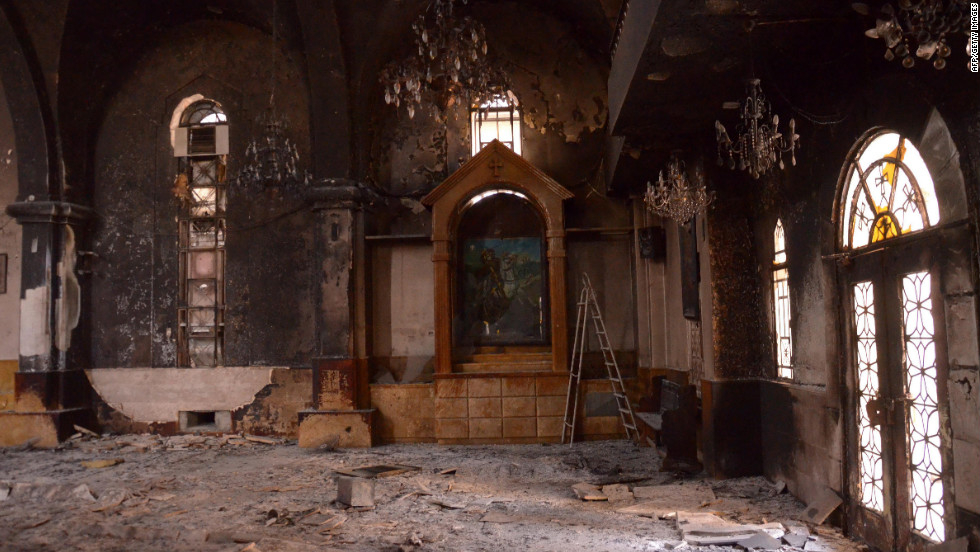The Armenian Surp Kevork Church (Saint George Church) in Aleppo shows damage on Tuesday from a fire that broke out during fighting between rebel fighters and Syrian government forces.
