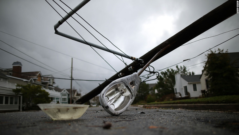 A street light and utility pole lie on the street in Avalon, New Jersey, on Tuesday.
