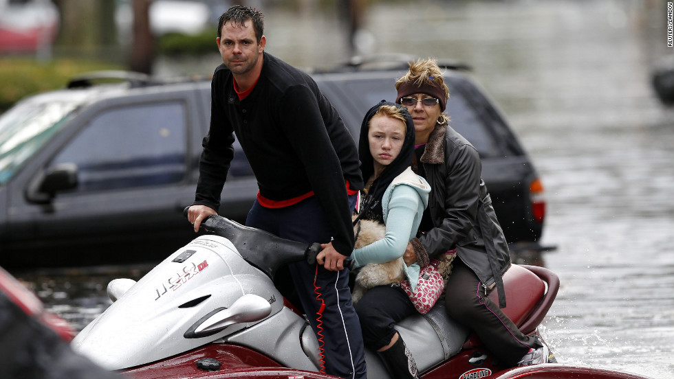 A resident of Little Ferry, New Jersey, assists in rescue efforts with his personal watercraft on Tuesday.