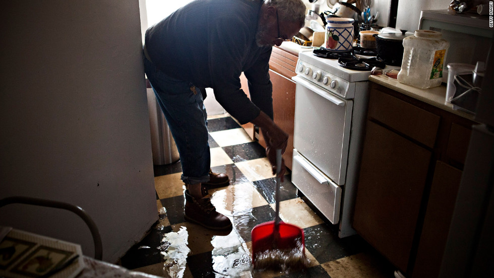 Jolito Ortiz helps clean up a friend's apartment on New York's lower east side on Tuesday.