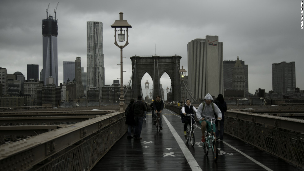 Pedestrians and bikers cross the Brooklyn Bridge after the storm on Tuesday.