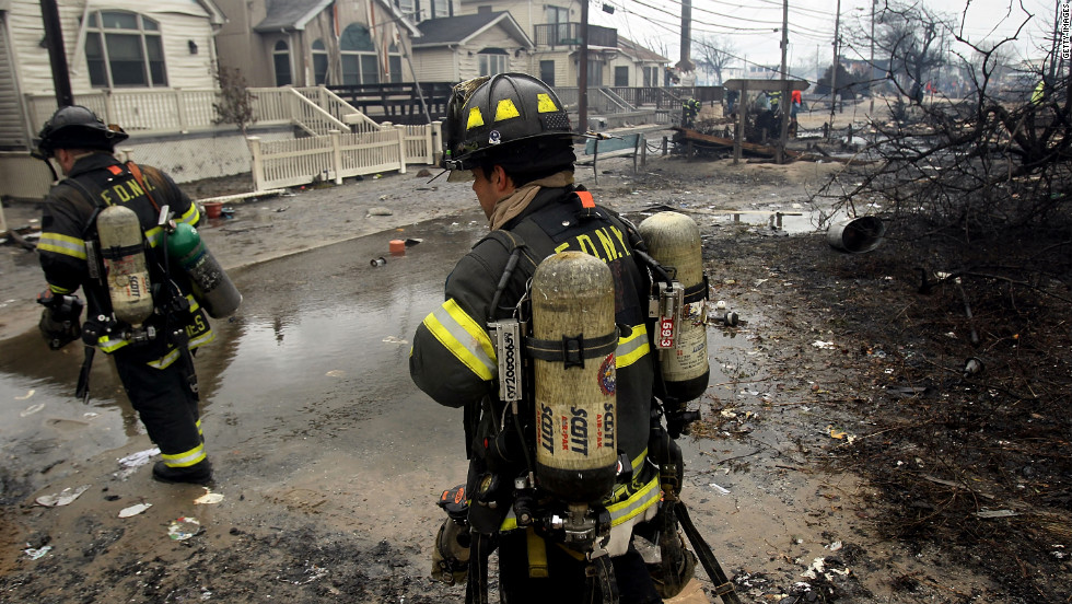 Firefighters work to contain the fire in Queens on Tuesday. Some 200 firefighters battled the six-alarm blaze.