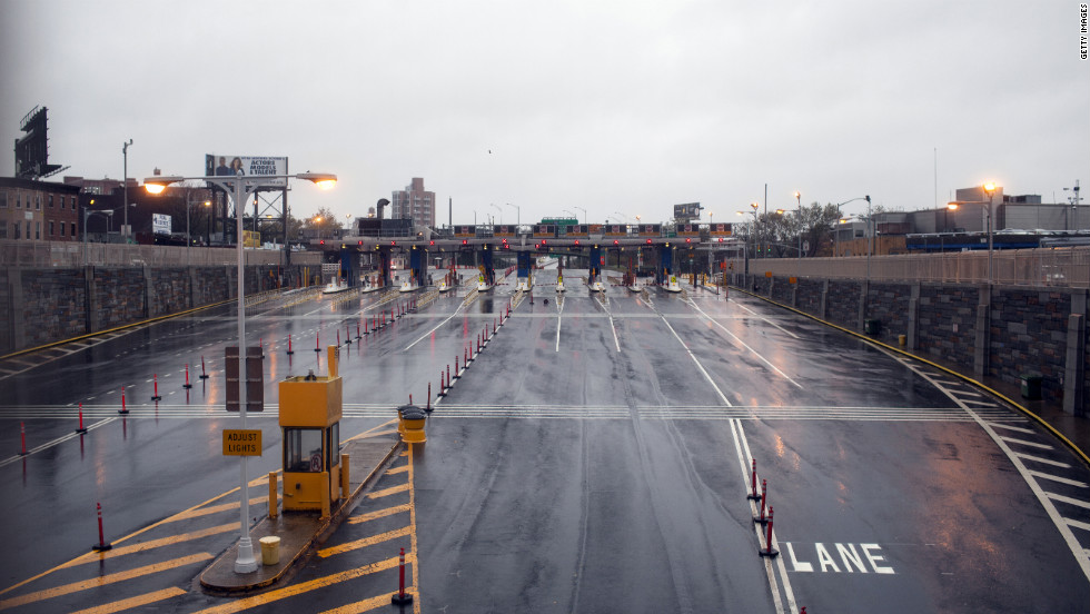 Empty toll booths remain closed on Monday at the Brooklyn Battery Tunnel in New York.
