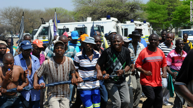 Some of the 12,000 miners sacked by Anglo American Platinum protest their dismissal in Rustenberg on October 6, 2012.