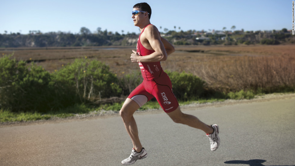 """I try to run 'tall' when training or racing,"" Ironman champion and ASICS athlete Andy Potts says. ""By running 'tall,' I mean that I try to keep my shoulders, hips, knees and ankles in the same plane without bending or 'breaking' at the hips."""