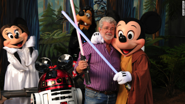 In this handout image provided by Disney, 'Star Wars' creator and filmmaker George Lucas meets a group of 'Star Wars'-inspired Disney characters Aug. 14, 2010 at Disney's Hollywood Studios theme park in Lake Buena Vista, Fla.