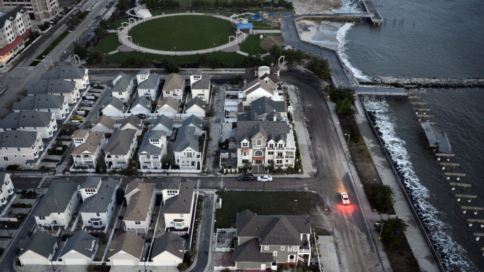 A police car patrols an empty waterfront neighborhood without power in Atlantic City, New Jersey, on Wednesday.