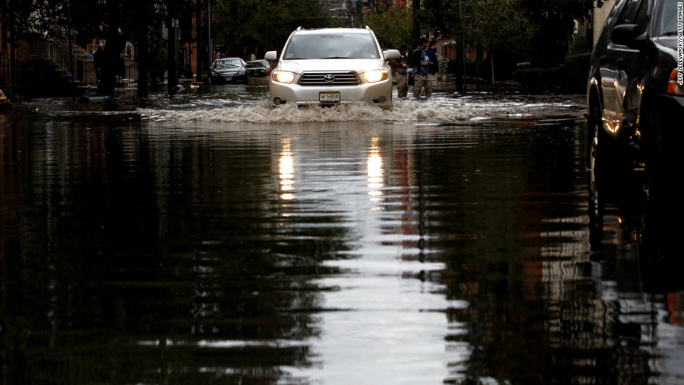 Motorists drive through standing water in Hoboken, New Jersey. Known as the Mile Square City, the low-lying neighborhoods suffered deep flooding resulting from the storm surge associated with Hurricane Sandy.