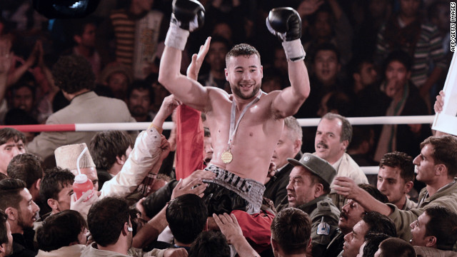 Hamid Rahimi is mobbed by supporters after winning Afghanistan's first professional bout in Kabul.