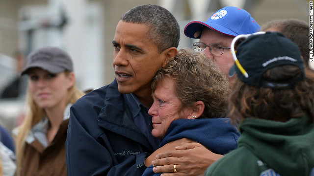 US President Barack Obama comforts Hurricane Sandy victim Dana Vanzant as he visits a neighborhood in Brigantine, New Jersey