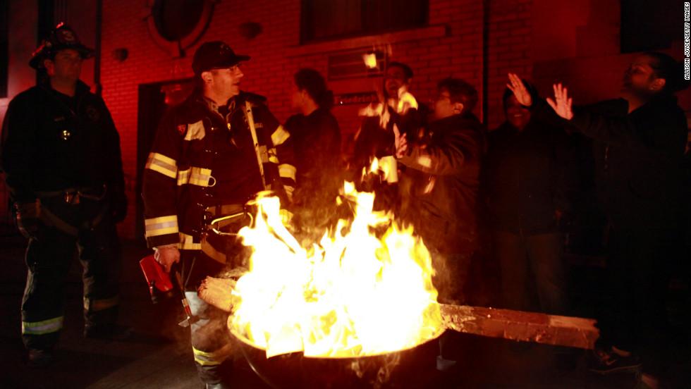Residents of New York City's East Village enjoy a bonfire on Wednesday, October 31.