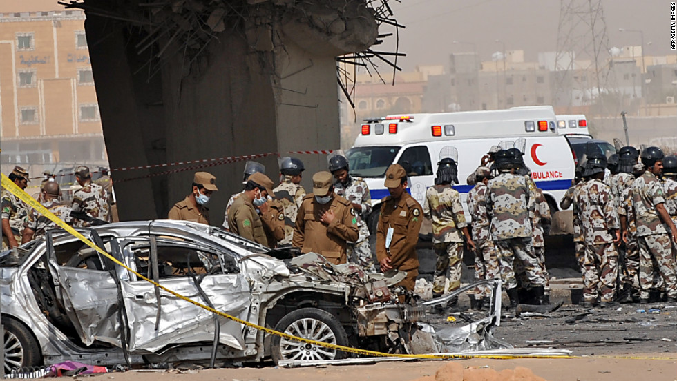 Saudi rescue workers are seen at the site where a truck transporting gas exploded on November 1, 2012 in Riyadh.