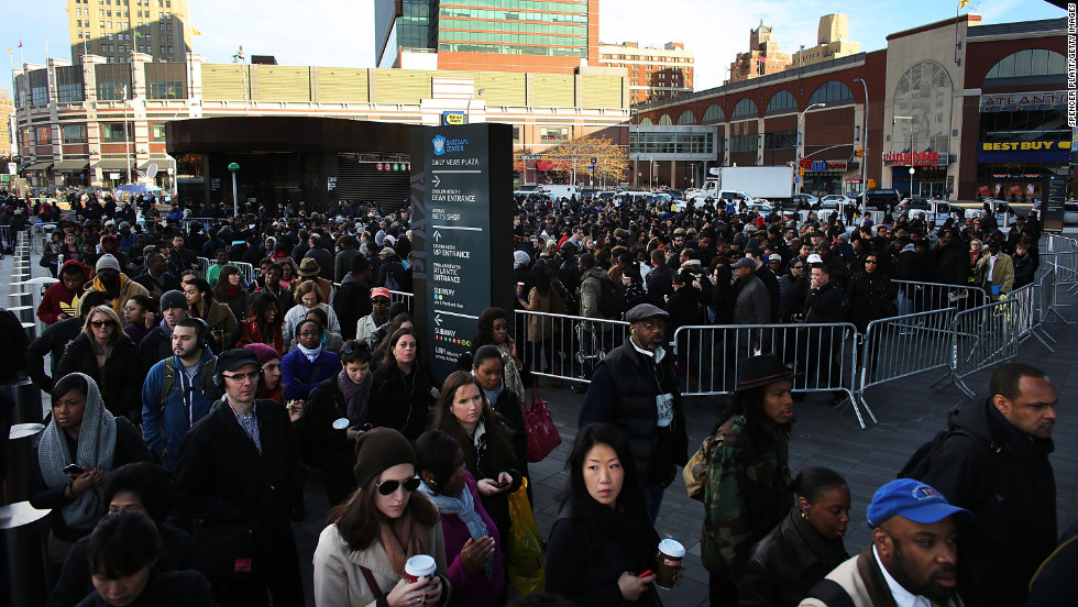 "Thousands of people wait to board city buses into Manhattan, and some subway lines remain underwater. Getting water out of the tunnels is ""one of the main orders of business right now,"" Gov. Andrew Cuomo said Thursday."