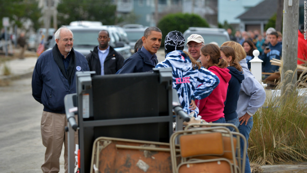 President Obama talks with Sandy victims at a neighborhood in Brigantine, New Jersey, as he travels around surveying the storm damage.