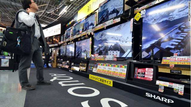 A customer checks LCD television sets made by Japanese electronics maker Sharp on November 1.