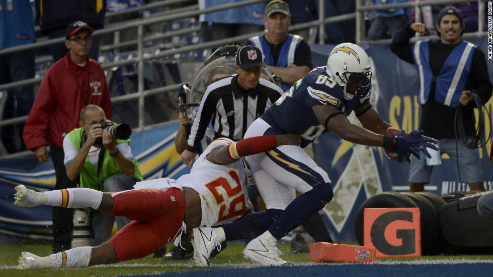 Antonio Gates of the San Diego Chargers scores a touchdown against Eric Berry of the Kansas City Chiefs on Thursday, November 1, at Qualcomm Stadium in San Diego.