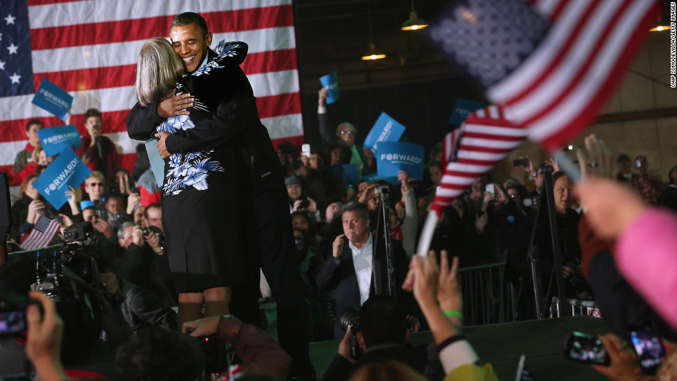 President Barack Obama embraces Judith Kamalay after she introduced him during a campaign rally Friday, November 2, in Hilliard, Ohio.