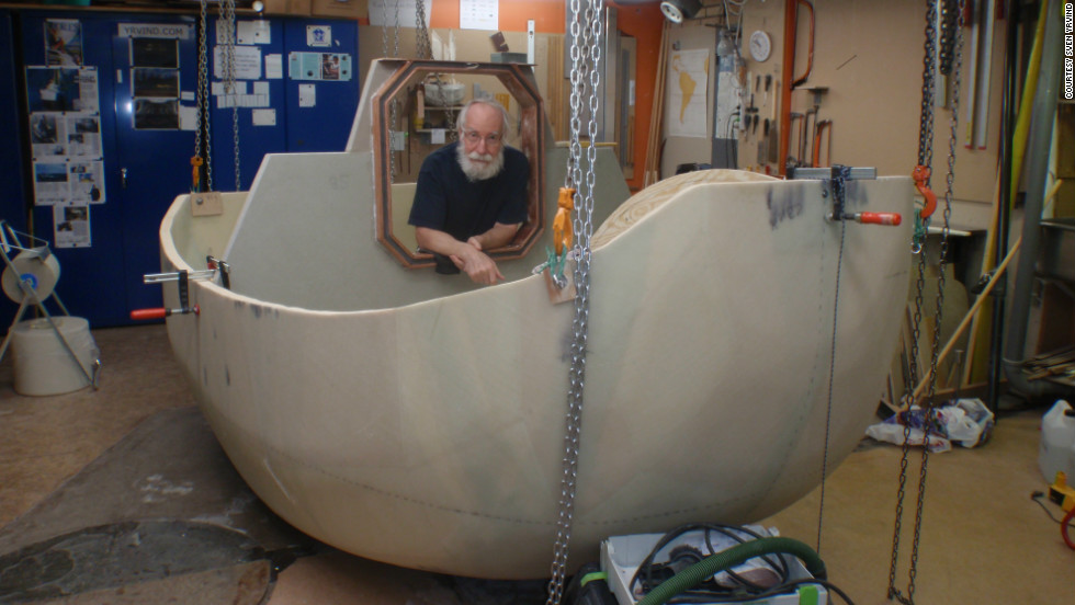 Sven Yrvind with his half-constructed vessel, Yrvind Ten. The 73-year-old plans to sail the three meter boat around the world.