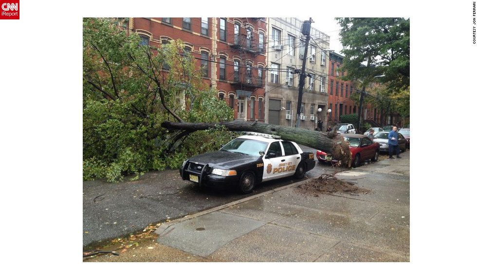 iReporter Jon Ferrari took this photograph Monday afternoon, October 29, in Jersey City showing a fully uprooted tree.