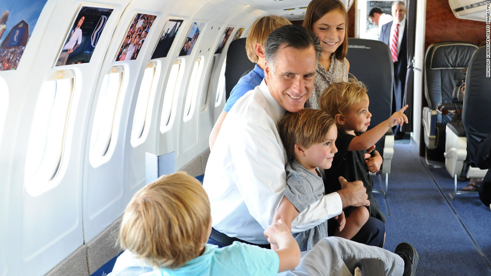 Mitt Romney plays with his son Josh's five children aboard his campaign plane in 2012.