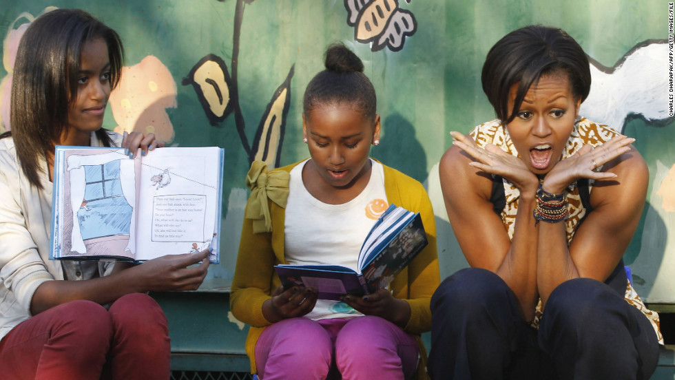 "First lady Michelle Obama, daughters Malia, left, and Sasha, center, take turns reading to children from ""The Cat in the Hat"" by Dr. Seuss as they visit South Africa in 2011."
