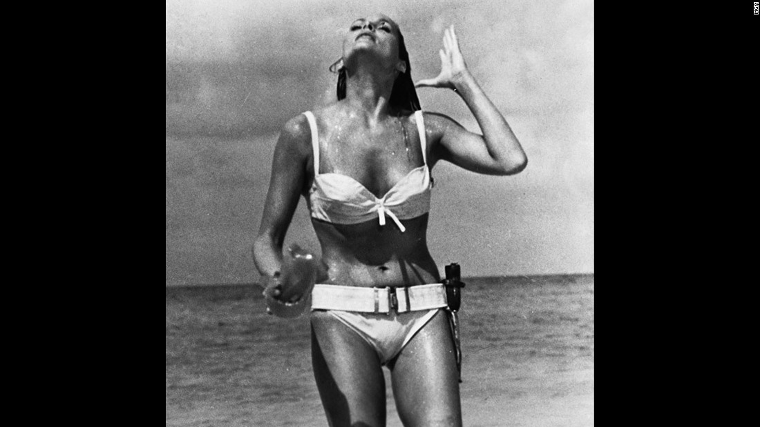"Ursula Andress played Honey Ryder opposite Sean Connery's James Bond in the 1962 film ""Dr. No."" Bond first sees Ryder as she emerges from the ocean wearing a white bikini. She asks him, ""What are you doing here? Looking for shells?"" He replies, ""No. I'm just looking."""