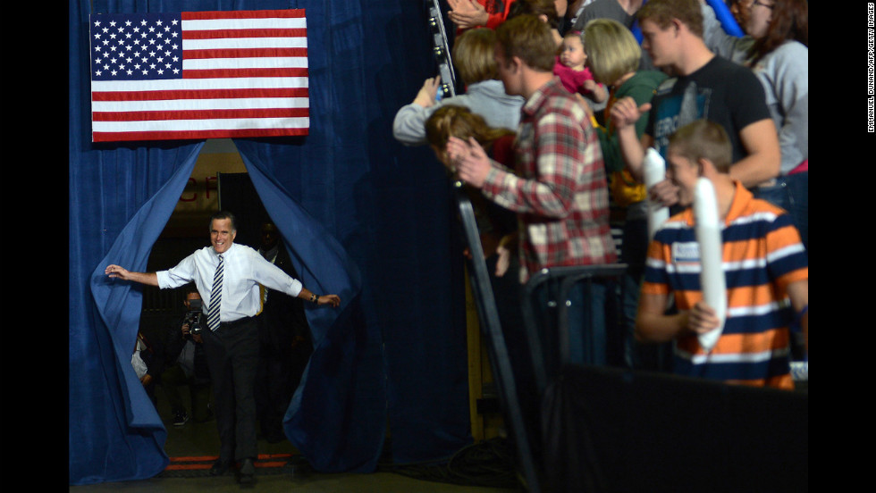 Romney arrives at Sunday's rally in Des Moines.