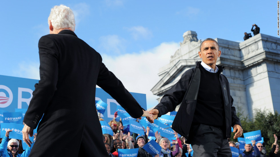 Obama is greeted by former President Bill Clinton during a campaign rally in Concord, New Hampshire, on Sunday, November 4. Obama and Romney darted from swing state to swing state, trying to fire up enthusiasm among supporters and win over any last wavering voters before Election Day.