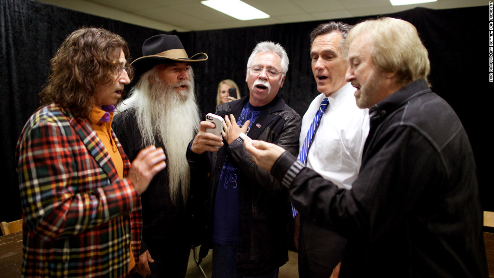 Romney sings with the Oak Ridge Boys backstage before a rally in Marion, Ohio, on Oct. 28, 2012.