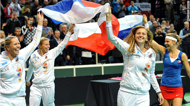 Czech Fed Cup members (from left) Lucie Hradecka, Andrea Hlavackova, Petra Kvitova and Lucie Safarova celebrate Sunday's victory on their home courts in Prague.