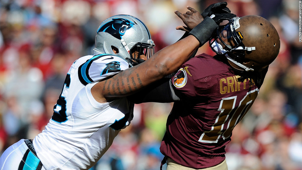 Greg Hardy of the Carolina Panthers hits Robert Griffin III of the Washington Redskins and is charged with a roughing-the-passer penalty during the first half at FedEx Field on Sunday in Landover, Maryland.