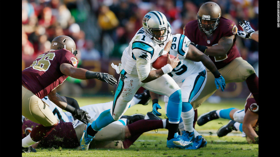Quarterback Cam Newton of the Panthers rushes the ball against the Redskins during the second quarter on Sunday.