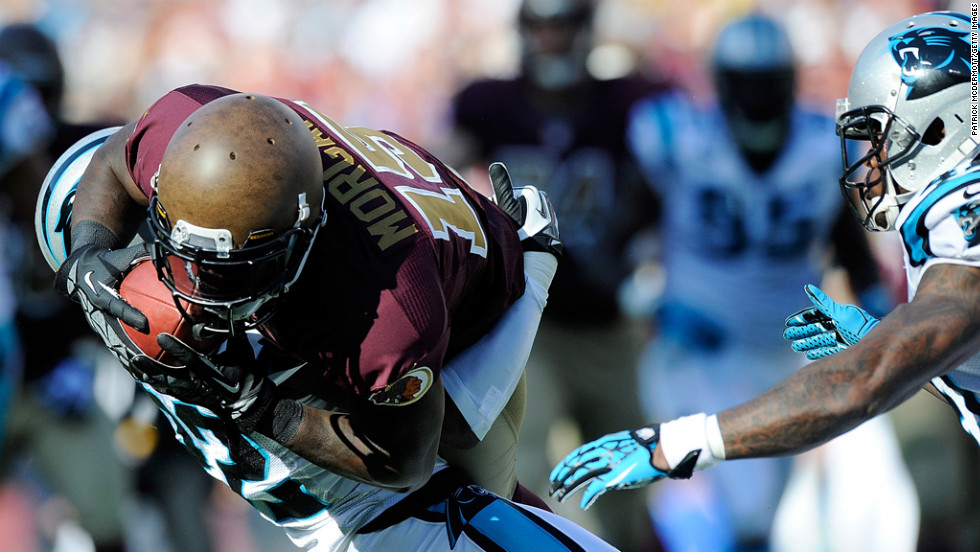 Josh Morgan of the Redskins makes a catch for a first down against the Panthers on Sunday.
