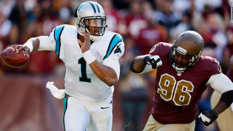 Quarterback Cam Newton of the Panthers scrambles while being chased by nose tackle Barry Cofield of the Redskins during the second quarter on Sunday.