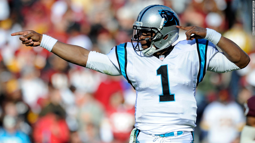 Cam Newtonof the Panthers celebrates after running for a first down against the Redskins on Sunday.