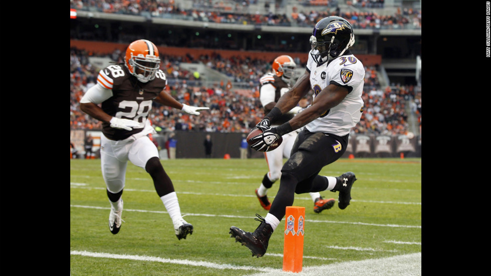 Running back Bernard Pierce of the Ravens scores a touchdown in front of defensive back Usama Young of the Browns on Sunday.