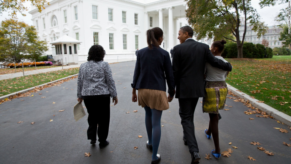 Obama walks with daughters Sasha, right, and Malia, center, and Kaye Wilson as they return to the White House from St. John's Episcopal Church in Washington on Oct. 28, 2012.