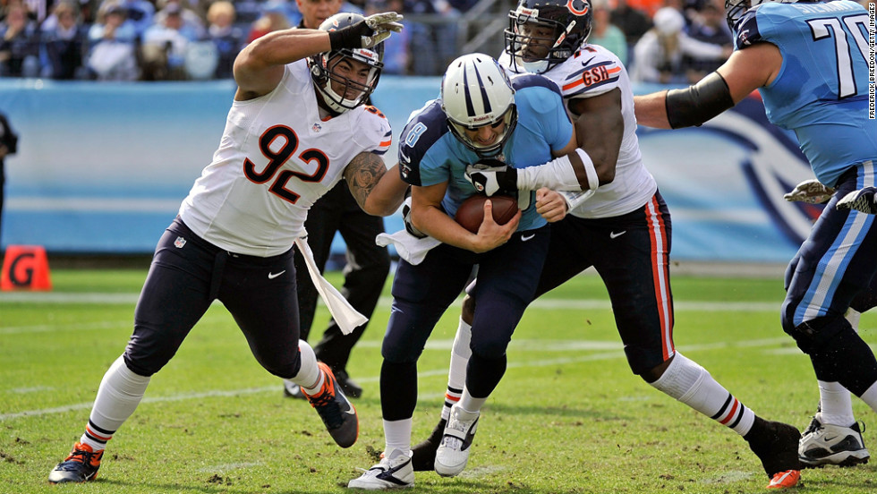 Matt Hasselbeck is sacked by Israel Idonije and Stephen Paea of the Bears on Sunday.