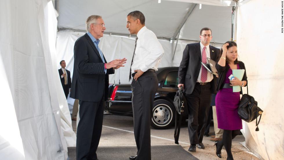Obama greets Senate Majority Leader Harry Reid, D-Nevada, at the Cheyenne Sports Complex in Las Vegas on Nov. 1, 2012.